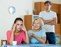 Mother-in-low comforting girl after quarrel with husband Stock Photography