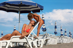Mother lying on lounger. daughter stay near Royalty Free Stock Photo
