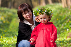 Mother made ​​a wreath of flowers Royalty Free Stock Image