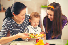 Mother making breakfast for her children Royalty Free Stock Photography