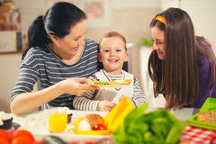 Mother making breakfast for her children Royalty Free Stock Images