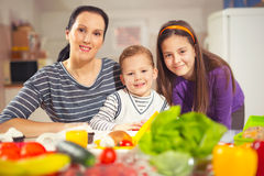 Mother making breakfast for her children in the morning at home Stock Photos