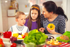 Mother making breakfast for her children in the morning at home Stock Images