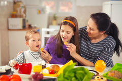 Mother making breakfast for her children in the morning at home Royalty Free Stock Photo