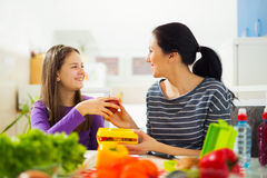 Mother making breakfast for her children in the morning and a sn Stock Photos