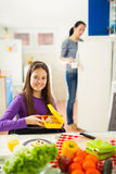Mother making breakfast for her children in the morning and a sn Stock Photo