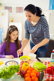 Mother making breakfast for her children in the morning and a sn Royalty Free Stock Image