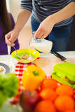 Mother making breakfast for her children in the morning and a sn Stock Image