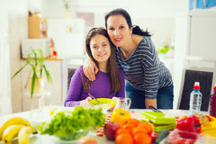 Mother making breakfast for her children in the morning and a sn Royalty Free Stock Photo