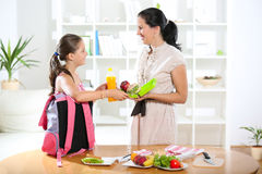Mother making breakfast for her children Royalty Free Stock Photos