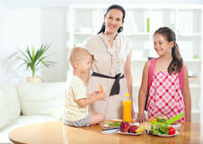 Mother making breakfast for her children Stock Image