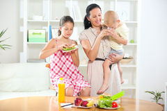 Mother making breakfast for her children Stock Images
