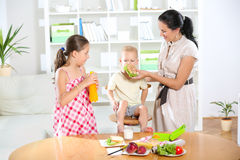 Mother making breakfast for her children Stock Photography