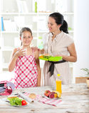 Mother making breakfast for her children Stock Photo