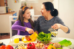 Mother making breakfast for her children in the morning Royalty Free Stock Images