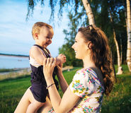 Mother making her child laughing Royalty Free Stock Photo