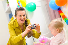 Mother making photos of babys first birthday Stock Photography