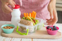Mother making school lunch in the kitchen royalty free stock photo