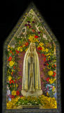 Mother Marie. Idol of Mother Marie decorated with flowers Stock Image