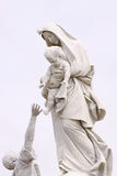 Mother Mary. And a fisherman Stock Image