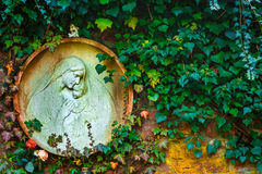 Mother Mary and Jesus Born Christianity Religion in Nature. In Graveyard Cemetery Royalty Free Stock Photo