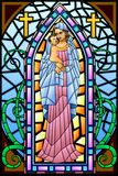 Mother Mary with Jesus Christ. Easy to edit vector illustration of Mother Mary with Jesus Christ in stained glass painting Stock Photo