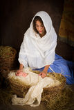 Mother Mary in nativity scene Stock Photo