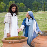 Mother Mary saying to Jesus there is no wine left. Biblical scene play of the miracle of transformation of water into wine - Mother Mary saying to Jesus there is stock image