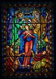 Mother Mary. Stained glass window depicting Mother Mary and the Holy Trinity in Ponte de Lima, a town in the Northern Minho region in Portugal Stock Image