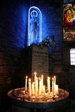 Mother Mary Statue and Candles Stock Photo