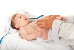 Mother massaging baby legs Royalty Free Stock Images