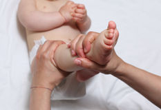 Mother massaging foot on baby Royalty Free Stock Photo
