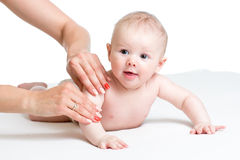 Mother massaging her baby Stock Images