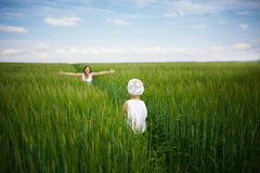 Mother meeting her baby in green field Royalty Free Stock Image