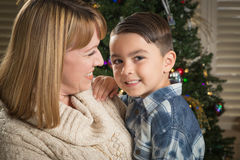 Mother and Mixed Race Son Hug Near Christmas Tree Royalty Free Stock Images