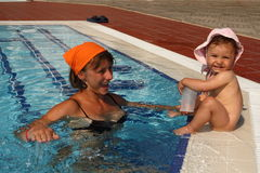 Mother mom with baby in the pool Royalty Free Stock Image