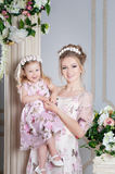 Mother, mom and daughter in the same dresses in studio Royalty Free Stock Image