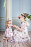 Mother, mom and daughter in the same dresses in studio Stock Photos