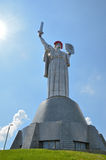 Mother Motherland in the mourning wreath. Monumental statue of the Mother Motherland is decorated with the sorrowful crown of the red poppies Stock Photos