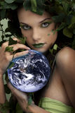 Mother nature protecting earth Stock Images