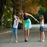 Mother with naughti son adn daughter on a walk in park. On summer evening royalty free stock image