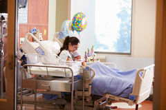 Mother With New Born Baby In Post Natal Department Stock Image