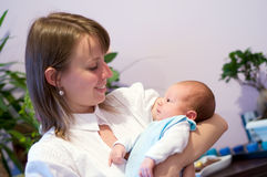 Mother with newborn. Two week baby with mother looking face to face Stock Photos