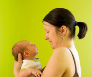Mother with newborn. Five weeks baby lookking stright at its mother Stock Images