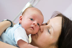 Mother with newborn. Six week baby in mother's arms looking straight at camera Stock Image