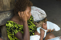 Happy mother and newborn Baby, Papua New Guinea royalty free stock photo