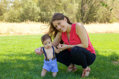 Mother and Newborn Baby. Having fun on a sunny day in the park Royalty Free Stock Photos