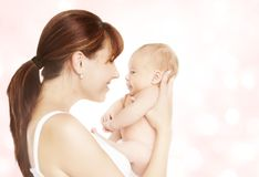 Mother and Newborn Baby, Mom Looking to New Born Child. Face to Face, Kid One Month Old Stock Photo