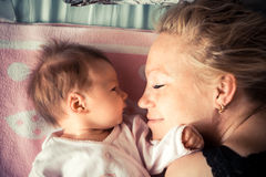 Mother with newborn baby sleeping. Symbolizing love and child care Stock Photo