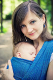 Mother with newborn baby in a sling Royalty Free Stock Images